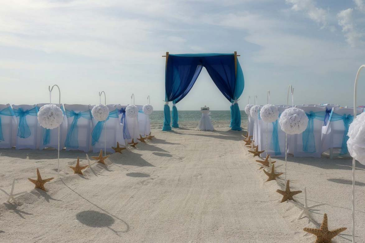 royal blue and turquoise with white pomanders - blue and white beach wedding